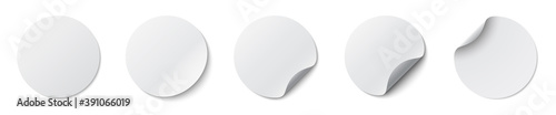 Fototapeta Circle adhesive symbols. White tags, paper round stickers with peeling corner and shadow, isolated rounded plastic mockup, realistic set round paper adhesive sticker mockup with curved corner - vector obraz