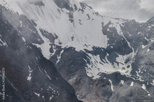 Cuadros en Lienzo Atmospheric minimalist textured alpine landscape with massive hanging glacier on big mountain in low clouds