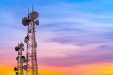 Telecommunication Tower At Sunset Sky Background