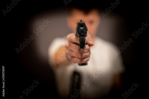 Obraz na plátně Man with gun facing to camera, pistol, weapon, dangerous, robbery,