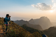 Adventure Photographers Taking Photos Of Mountain And Landscape In The Dusk Near The Sunset At Doi Luang Chiang Dao, Chiang Mai, Thailand. Taking From Top Of The Mountain.