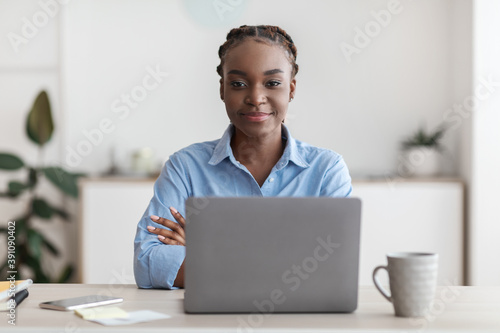 Female Entrepreneurship. Portrait Of Young Black Businesswoman Posing At Desk In Office