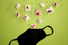 Christmas Gift Boxes With A Cloth Black Face Mask - Flat Lay
