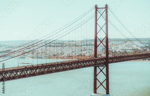 Fototapeta premium A suspension red rope bridge between Lisbon and Almada, Portugal named