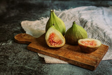 Fresh Figs On The Wooden Board...