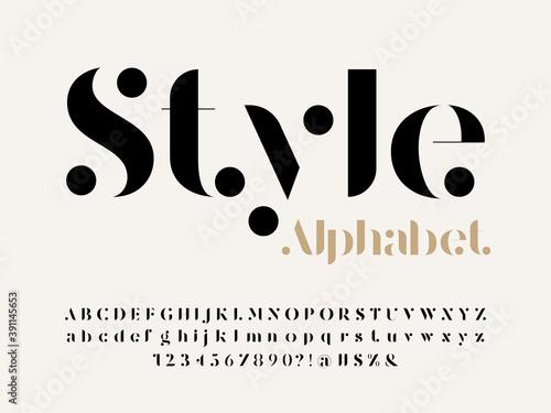 Fototapeta Modern serif alphabet design with uppercase, lowercase, numbers and symbol obraz