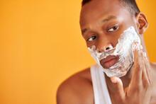 Black African Man Apply Foam S...