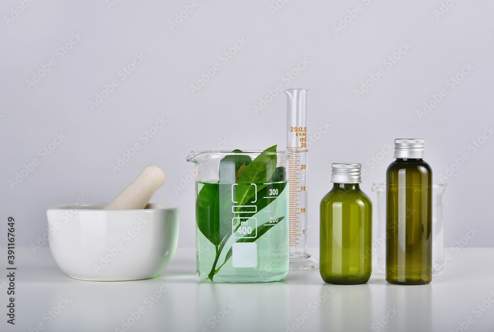 Fototapeta Natural skincare beauty product research, Organic botany extraction in scientific glassware at science laboratory, Blank cosmetic bottle container for branding mock-up.