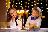 Kids celebrating Hanukkah. Festival of lights.
