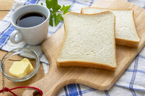 Fotografia 食パンとコーヒーとバター