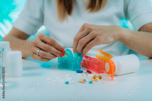 Obraz Medicine non adherence. Woman holding pills in her hand, not sure if she had taken the medicine or not - fototapety do salonu