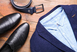 Classic blue men's costume with black leather shoes and a belt
