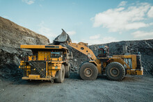 The Wheel Loader Loads The Ore Into The Mining Dump Truck.