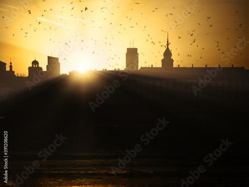 Obraz Wschód słońca w Warszawie - fototapety do salonu