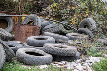 Large Tires Thrown In Nature. Used Tire Storage.