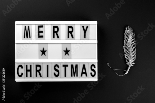 Merry Christmas lettering on lightbox.Festive composition