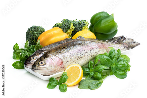 Raw fresh rainbow trout with assortment vegetables and lemons Fotobehang