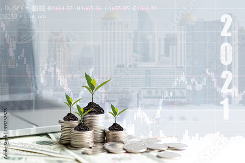 Tela 2021 New year on growing up money coin stack for investment