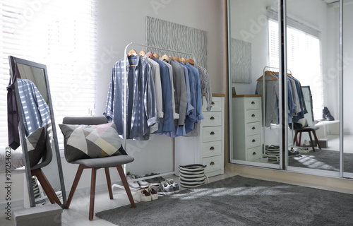 Obraz Dressing room interior with clothing rack and mirror - fototapety do salonu