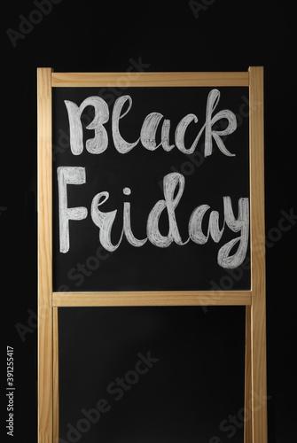 Fototapeta Board with phrase Black Friday on dark background obraz