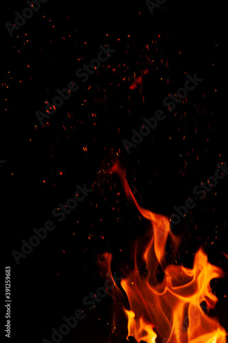 Fiery flame with sparks on a black background Canvas-taulu