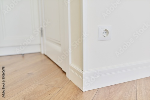 Photo Repair in the house, apartment, close-up detail of the interior, floor plinth