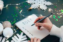 Hand Writing New Year 2021 Goals List