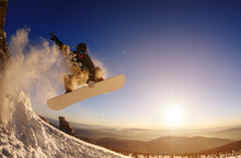 Snowboarder Jumping Against Th...