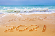 2021 Written On The Sand Of A Beach, Travel 2021 New Year Concept And Greeting Card