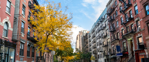Fotografering Panoramic view of historic buildings along 15th Street with colorful fall trees