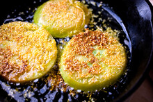 Fried Green Tomatoes On Frying Pan