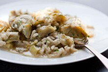 Close Up Of Artichoke Risotto On Plate