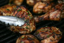 Close Up Of Grilled Chicken On Grill