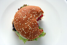 Close Up Of Hamburger With Lettuce And Tomato
