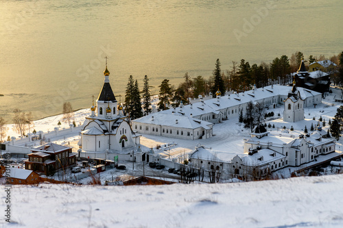 The Holy Assumption Monastery near Krasnoyarsk has a long history, but it still exists and is good year after year Fotobehang