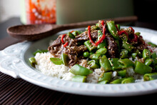 Close Up Of Fried Beef With Rice And Sugar Snap Peas