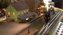 Replica Model Of Railway Station. Coming Lokomotive Train.