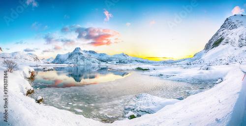 Gorgeous frozen Flakstadpollen and Boosen fjords with cracks on ice during sunri Fotobehang