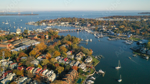 Stampa su Tela Aerial view of colorful sailboat moorings and docks on Spa Creek, in historic do