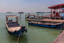 Fishing Boats Moored At The Clan Jetties With The Penang Bridge In The Distance In George Town, Penang Island, Malaysia, Asia