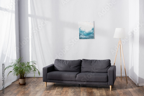 Fototapeta soft comfortable sofa in living room near potted plant