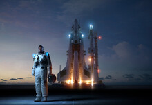 Astronaut At Space Shuttle Launch At Dusk