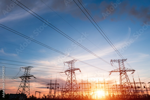 Tela Electrical substation silhouette on the dramatic sunset background