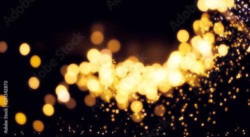 Fotomural Weihnachtlich Goldenes Bokeh auf einem schwarzem Hintergrund mit einem Licht Schimmer