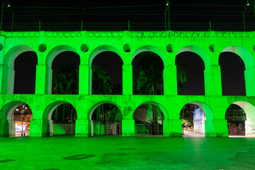 Beautiful view to old white aqueduct with green lights at night