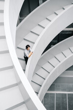 Businessman Using Smartphone On Stairs