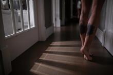 A Girl Walks Barefoot Around T...