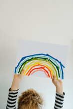 Boy Crafting A Rainbow With Colorful Washi Tape