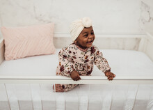 Baby Girl In Crib Smiling