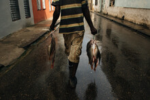 Unknown Man Carries Fresh Fish...